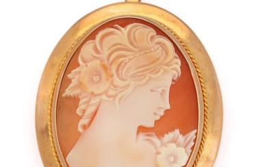 SOLD. A cameo brooch/pendant set with a cameo of carved shell, mounted in 14k gold....