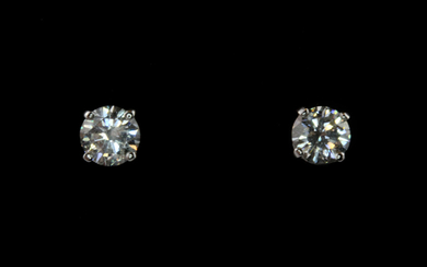 A pair of 18ct white gold stud earrings set with brilliant cut diamonds, approx. 1.30ct overall, clarity SI, colour H-I.