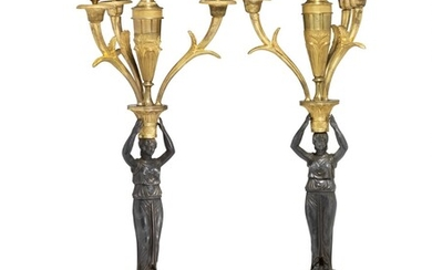 A pair of Empire gilt and patinated bronze candelabra. French, early 19th century. H. 56 cm. W. 22 cm. (2)