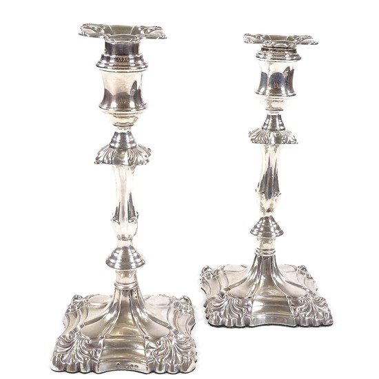 A pair of Victorian silver candlesticks, with removable fitt...