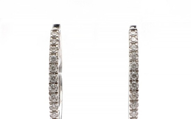 A pair of diamond ear pendants each set with numerous brilliant-cut diamonds weighing a total of app. 0.26 ct., mounted in 18k white gold. L. app. 1.9 cm. (2)