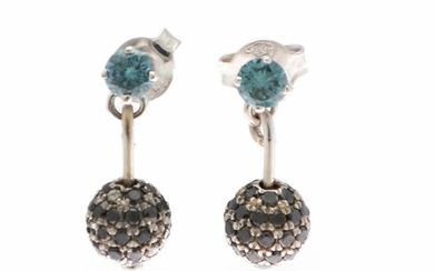 A pair of diamond ear studs each with a brilliant-cut diamond and a bead set with numerous black diamonds, mounted in 14k white gold. (2)