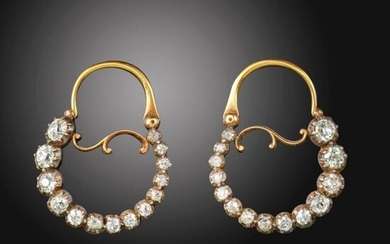 A pair of early 19th century diamond hoop earrings, set with graduated old cushion-shaped diamonds in silver cut-down collets on gold fittings, 2.2cm wide, in leather earring stand/box