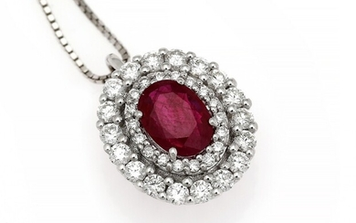 A ruby and diamond pendant set with a ruby encircled by numerous diamonds, mounted in...