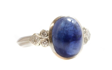 A single stone cabochon sapphire ring