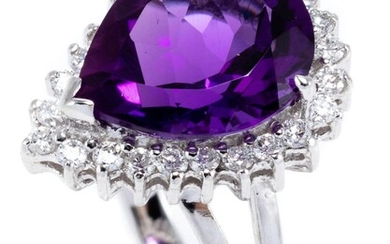 AN 18CT WHITE GOLD AMETHYST AND DIAMOND RING; pear cut amethyst of approx. 3.7ct within a border of 24 round brilliant cut diamonds...