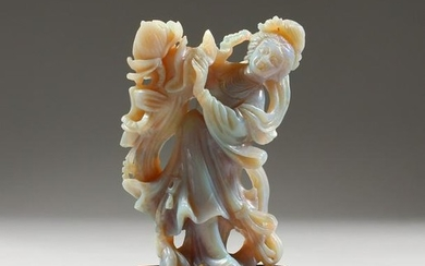 AN UNUSUAL CHINESE CARVED OPAL FIGURE, of a woman