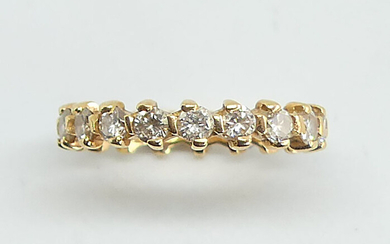 American ALLIANCE in yellow gold set with 19 diamonds. Gross weight 2.53 g. Diamond weight 1.52 ct. TTD 52