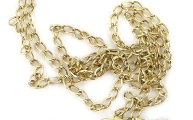 An 18ct gold whale pendant and chain, the whale...