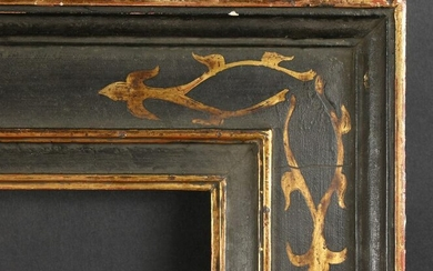 An Ebonised Shaped Frame with Gilt Painted Corners. 26""