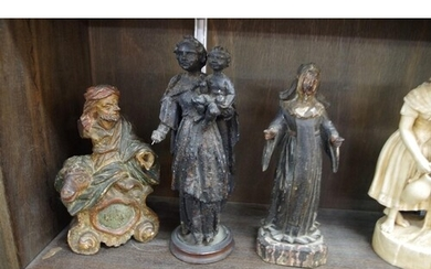An interesting group of three carved wood figures, prob...