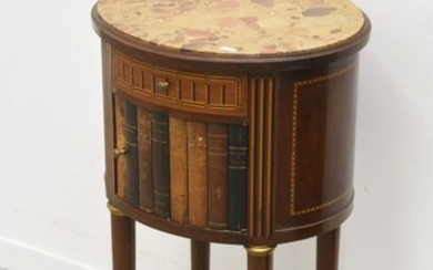 Bedside table with marble top, decorated with books...