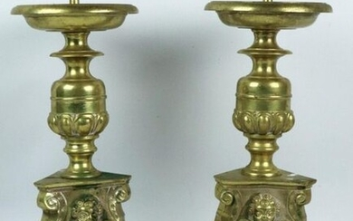 Pair of cast and chiselled brass picks, the base decorated with an angel.