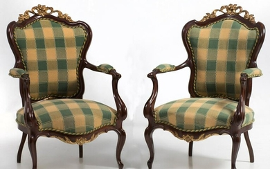 Pair of mahogany wooden armchairs with golden tufts