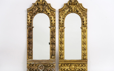 Pair of mirrors each in an antique baroque style frame in decorated and sculpted wood - 80 x 31 ||pair of mirrors each in an antique baroque style frame in guilded and sculpted wood