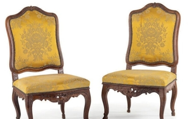 Pair of moulded and carved walnut chairs with...