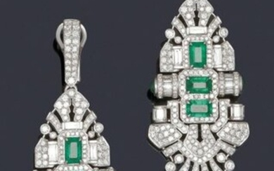 Pair of white gold earrings decorated with openwork scrolls and palmettes entirely set with brilliant-cut diamonds and baguette-cut diamonds set with three rectangular cut-faceted emeralds and cabochon emeralds. In the Art Deco taste. Longueur : 7,2...