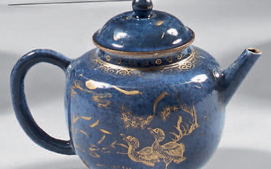 Teapot and its lid made of Chinese porcelain. 18th century. Globular in shape, with gold decoration of animals in a landscape standing out on a powdered blue background, gold wear and tear.