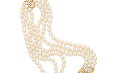 A triple strand cultured pearl necklace,