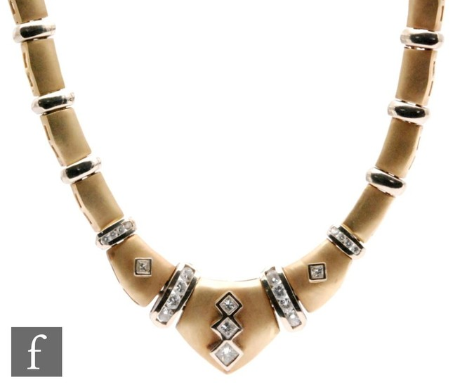 A 14ct white and yellow gold diamond set necklet, the matt f...