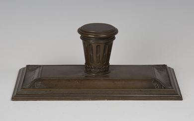A 19th century brown patinated cast bronze inkstand, the central stop fluted inkwell with hinged lid