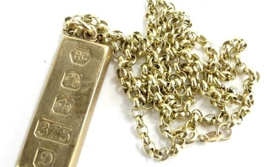 A 9ct gold ingot pendant and chain, the ingot...