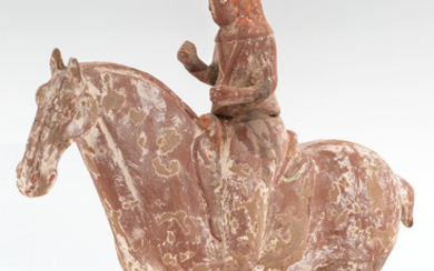 A CHINESE TERRACOTTA FIGURE OF A HORSERIDER, TANG DYNASTY (618-907)
