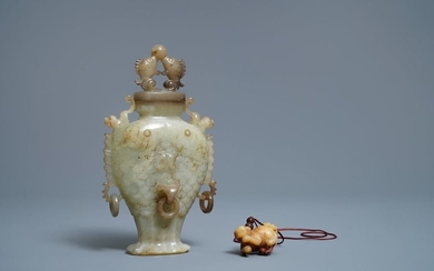 A Chinese jade 'twin fish' vase and a...