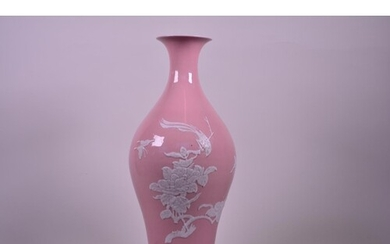 A Chinese pink ground porcelain vase with raised decoration ...