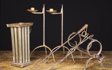 A Collection of Wrought Iron-ware: A 2½ ring pipe kiln, three pipe shaped candle snuffers, a 19th ce