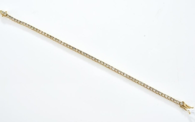 A DIAMOND LINE BRACELET WEIGHING 4.60CTS IN 18CT GOLD