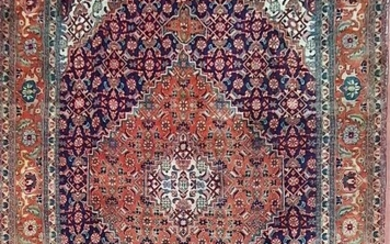 A HAND KNOTTED PURE WOOL PERSIAN TABRIZ