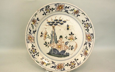 A Liverpool delft mid 18th century charger decorated
