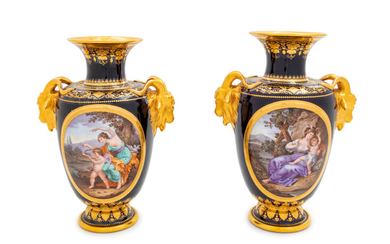 A Pair of Vienna Painted and Parcel Gilt Handled Porcelain Urns