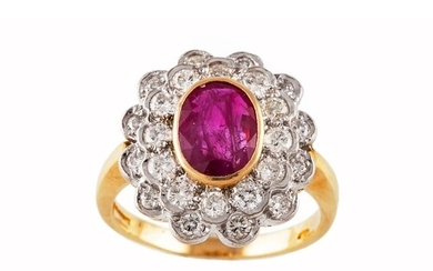 A RUBY AND DIAMOND CLUSTER RING, the oval ruby to a two rowe...