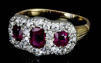 A Ruby and Diamond Cluster Ring, Modern, in gold...