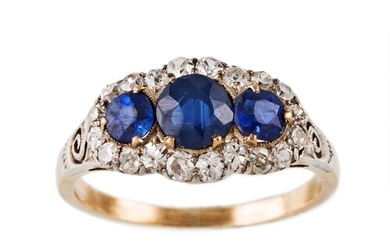 A SAPPHIRE AND DIAMOND CLUSTER RING, set with three circular...