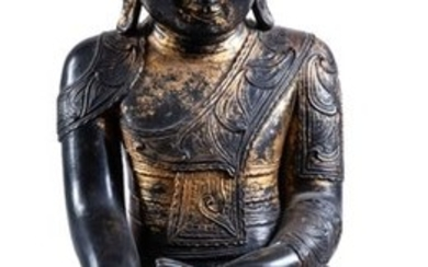 A carved gilt-lacquered wood figure of Buddha, 19th...