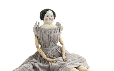 NOT SOLD. A circa 1870 porcelain head doll with cloth body, in original clothing with...