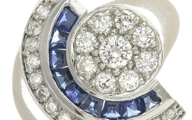 A diamond and sapphire dress ring.Estimated total