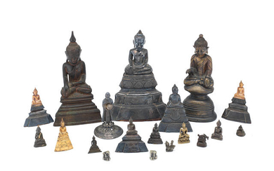 A large group of variously bronze, white metal and yellow metal Buddhist figures and weights
