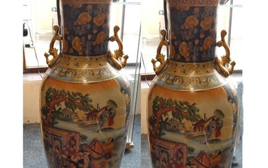 A large pair of chinese floor vases decorated with ladies an...
