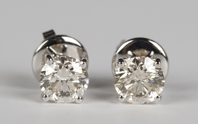 A pair of 18ct white gold and diamond single stone earrings, each claw set with a circular cut diamo