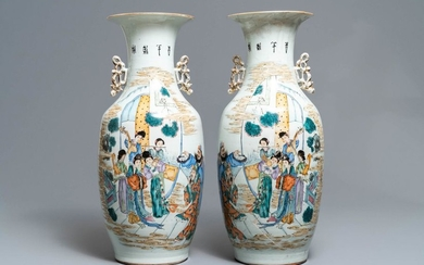 A pair of Chinese famille rose vases with...