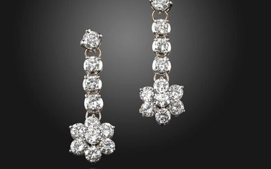 A pair of diamond drop earrings, the flowerhead section suspending from an articulated drop, set with round brilliant-cut diamonds in white gold, approximately 2.00cts total, post fittings, 3.2cm high