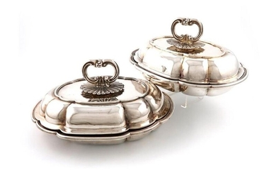 A pair of early-Victorian silver entrée dishes and...