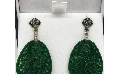 A pair of oval shaped patterned dyed jade drop earrings set ...