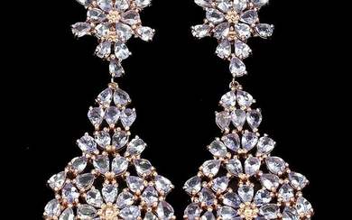 A pair of tanzanite ear pendants each set with numerous pear-shaped tanzanites, mounted in rose gold plated sterling silver. 2.4×6.6 cm. (2)