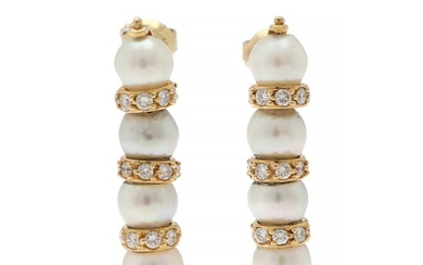 A pearl and diamond ear pendants each set with four cultured pearls flanked by numerous...
