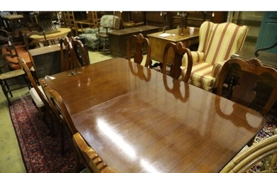 A reproduction mahogany twin pillar extending dining table a...